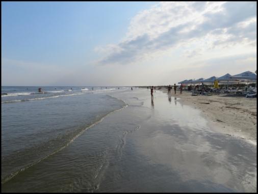 Sulina beach - people enjoying sunbathing and swiming