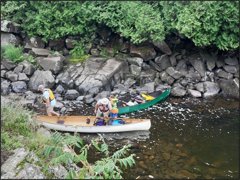 Portaging canoes at Recolett Falls